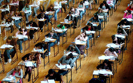 Fears over GCSE exam shake up...File photo dated 10/6/2005 of school exams in progess. Teenagers will no longer be required to sit all their GCSEs after two years of study, under radical plans to break courses into 'bite sized' modules. PA wire